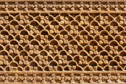 Rajasthani floral style haveli carving pattern in old building in Jaislamer city in Rajasthan state of India