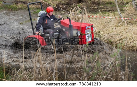 RAKOVICE, CZECH REPUBLIC - APRIL 4 2017: Tractor mud racing in village Rakovice #786841210