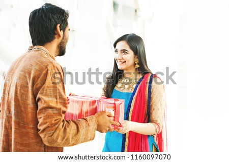 Raksha bandhan (rakhi, rakshabandhan) concept. Indian brother giving gift to his sister