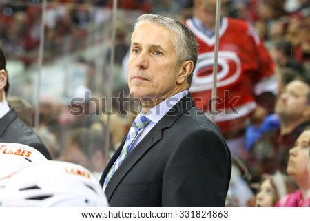 RALEIGH, NC â?? January 24, 2014: Calgary Flames head coach Bob Hartley during the NHL game between the Calgary Flames and the Carolina Hurricanes at the PNC Arena.