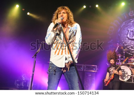 RALEIGH, NC - JULY 31: Lead singer David Coverdale and the classic rock band Whitesnake performs live in concert, on July 31, 2013.