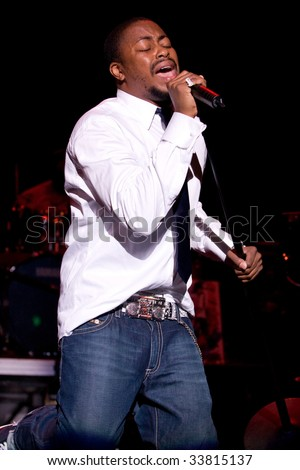 RALEIGH, NORTH CAROLINA-JUNE 28: Raheem DeVaughn performs on stage at Raleigh Memorial Convention Hall on June 28, 2008in Raleigh, North Carolina.