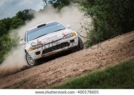 Rally car on dirt track