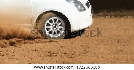Rally race car drifting on dirt track. Stock photo ©