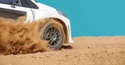 Rally racing car in dirt track.