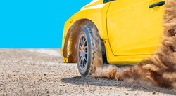 Rally racing car on dirt track.