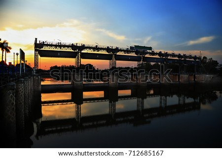 RAMA VI Dam at sunset time. It is the first diversion dam in Thailand and was built to hold the water of Pasak river in order to preserve water for agriculture. #712685167