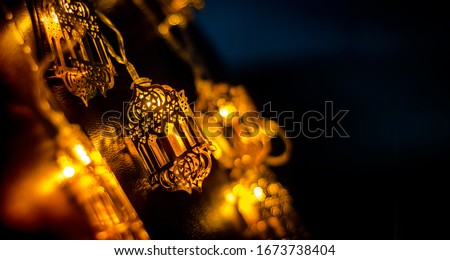 Ramadan and Eid al fitr Decoration Background 2020, Beautiful Yellow Color Arabic Traditional lantern light lamp, Islamic Decoration concept image Eid Mubarak, Yellow out of Focus Image