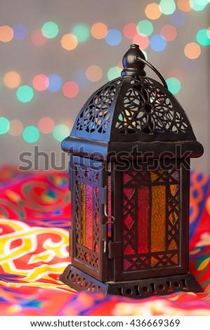 Ramadan Background - Lantern on Ramadan colorful fabrics
