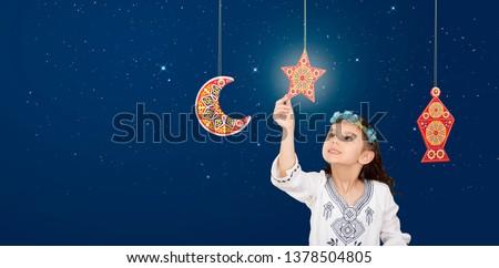 Ramadan background , Muslim Girl Celebrating Ramadan on blue sky background - Ramadan Kareem Social Greeting Card Banner