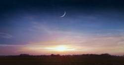 Ramadan background . Red sunset and moon . Mubarak background . Against the background of clouds . beautiful sky .  Sunset and new moon . Prayer time . Generous Ramadan . Dramatic nature background .