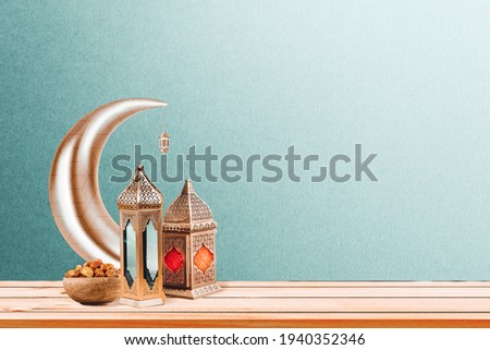 Ramadan concept. Dates close-up in the foreground. Ramadan Lanterns and a bowl of date on a wooden table. wall background. Space for text on the right. iftar concept image. Ramadan kareem 3d image.