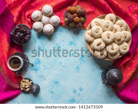 Ramadan food background. Eid eats. Ghorayeba sweets. Cookies of El Fitr Islamic Feast. #1412673509