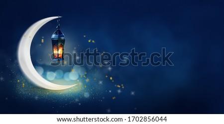 Ramadan Kareem background banner. Islamic Greeting Cards for Muslim Holidays and Ramadan. Blue banner with moon and lantern.