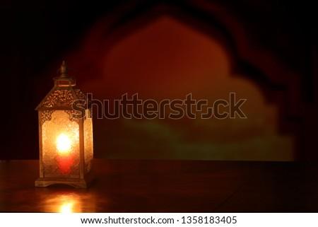 Ramadan Kareem background.Ramadan lantern on wooden  table #1358183405