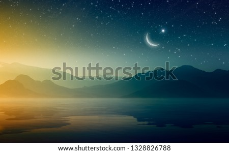 Ramadan Kareem background, rising crescent and stars above mountains and serene sea. Elements of this image furnished by NASA #1328826788