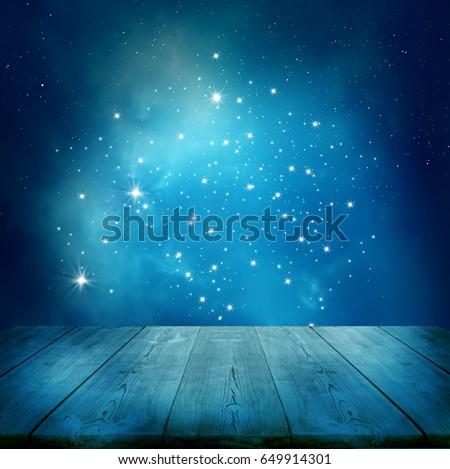 Ramadan Kareem background.Stars background  with wooden table #649914301