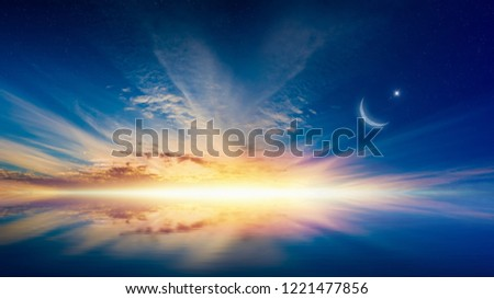 Ramadan Kareem background with crescent, stars and glowing horizon above serene sea. Elements of this image furnished by NASA #1221477856
