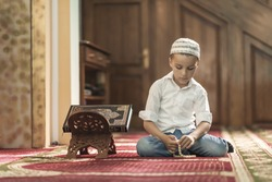 Ramadan Kareem,beautiful boy Muslim is praying in mosque,Peace and love in the holy month of Ramadan,lifestyle concept
