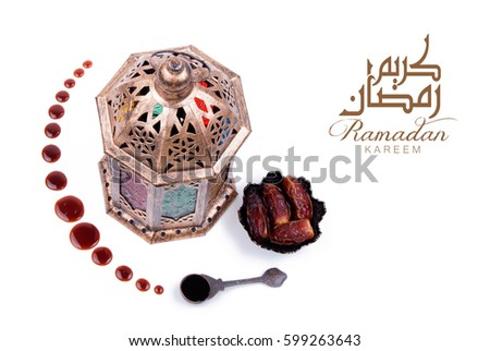 Ramadan Kareem . Dates and dates syrup poured in the shape of crescent moon.