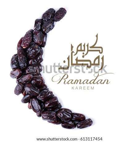 Ramadan kareem. Dates fruit arranged in shape of crescent moon.