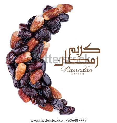 Ramadan kareem with dates arranged in shape of crescent moon.
