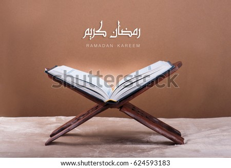Ramadan kareem with Holy Quran on wooden stand #624593183
