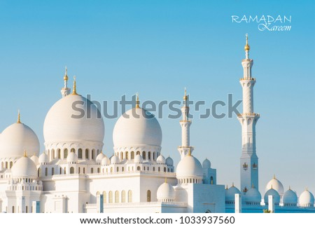 Ramadan kareem with sheikh zayed mosque in the background #1033937560