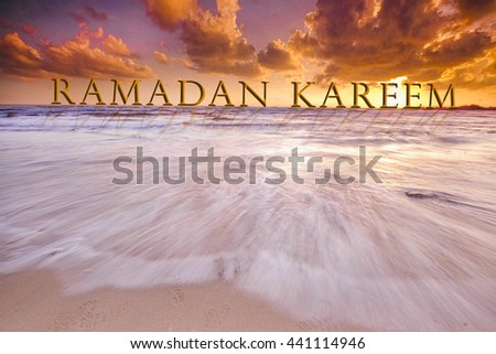 RAMADAN KAREEM word in dramatic sunset at clean beach with slow shutter lanscape, seascape #441114946