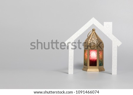 Ramadan Lantern behind paper house for greetings and background designs #1091466074
