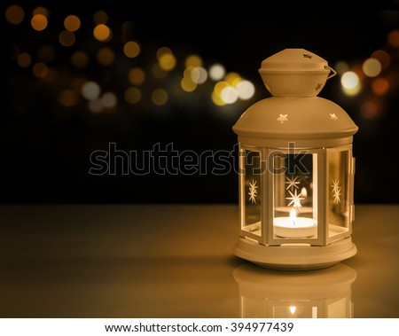 Ramadan lantern with night lights.\ Ramadan mood at night with light decoration in the background.