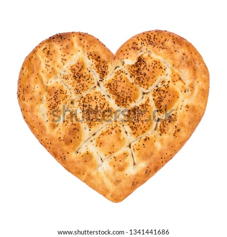 Ramadan Pita Heart Shaped (Ramazan Pidesi). Traditional Turkish bread for holy month Ramadan. Concept about love and relationship.  #1341441686