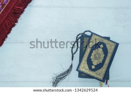 Ramadhan Kareem. Ramadhan objects. Holy Quran, beautiful beads, and prayer rugs. -Images #1342629524