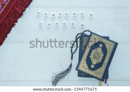 Ramadhan Kareem. Ramadhan objects. Holy Quran, beautiful beads, and prayer rugs. -Images #1344771671