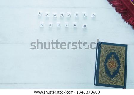 Ramadhan Kareem. Ramadhan objects. Holy Quran, beautiful beads, and prayer rugs. -Images #1348370600