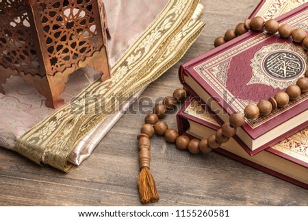 Ramadhan objects. Holy Quran and wooden cheekbones #1155260581