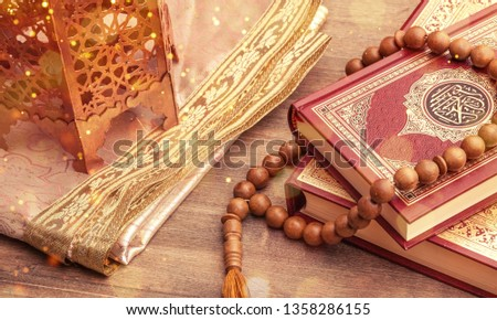 Ramadhan objects. Holy Quran and wooden cheekbones #1358286155