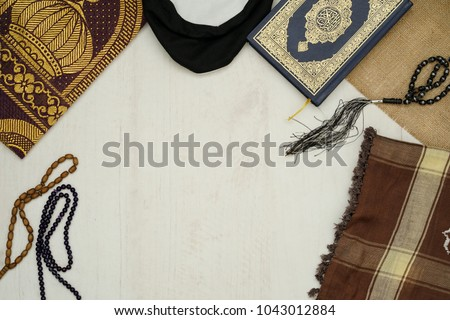 Ramadhan objects. Holy Quran, beautiful beads, prayer rugs, and moslem clothes. #1043012884