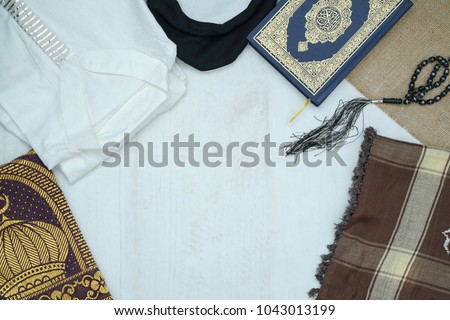 Ramadhan objects. Holy Quran, beautiful beads, prayer rugs, and moslem clothes. #1043013199