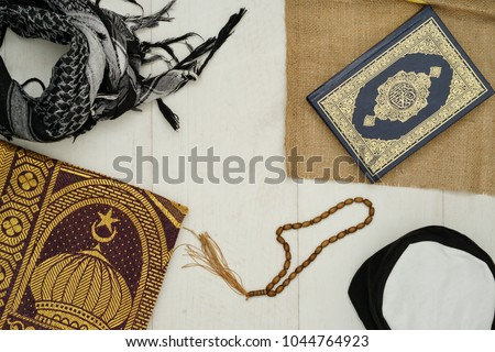 Ramadhan objects. Holy Quran, beautiful beads, prayer rugs, and moslem clothes. #1044764923
