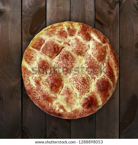 Ramazan pidesi (Turkish for Ramadan pita) is a traditional Turkish bread.  #1288898053