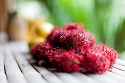 Rambutans closeup on wooden table
