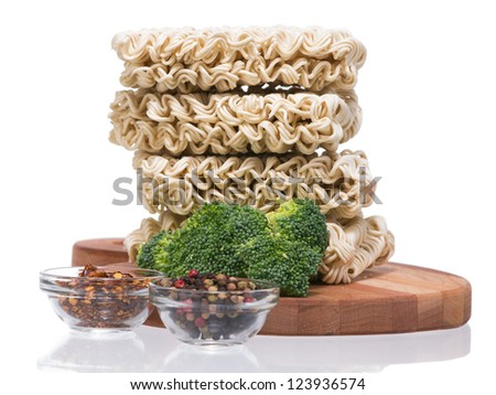 Ramen instant raw noodles on wooden plank 3/4 presentation 2 general view - stock photo