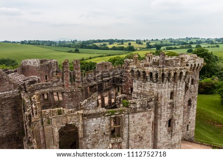 Ramparts and towers of a ruined medieval castle (Raglan Castle, Wales)