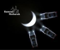 Ramzan Mubarak with car headlight creating moon shape on road