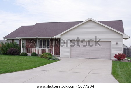 Ranch home with vinyl siding and brick veneer