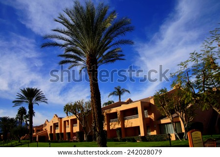 RANCHO MIRAGE, CALIFORNIA - DEC 20, 2014 - Southwestern style hotel buildings in green oasis with Palm trees,  Rancho Mirage, California