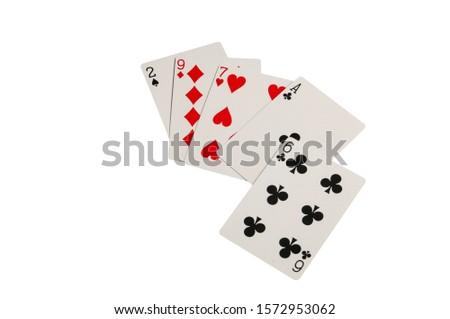 Random cards of a losing poker hand isolated on a white background.