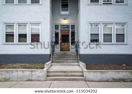 Random Fourplex in Minneapolis, Minnesota with Sidewalk and Cement Wall. #515034202