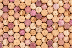 Random selection of used wine corks, wall of used corks, wine corks background, top view